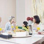 elderly care with family dinner