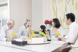 elderly care with family dinner