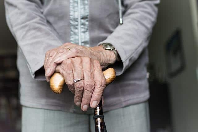 seniors hand, elderly holding a cane