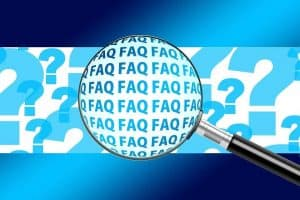 magnifying glass with faq words