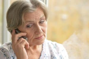 senior calling someone on the phone